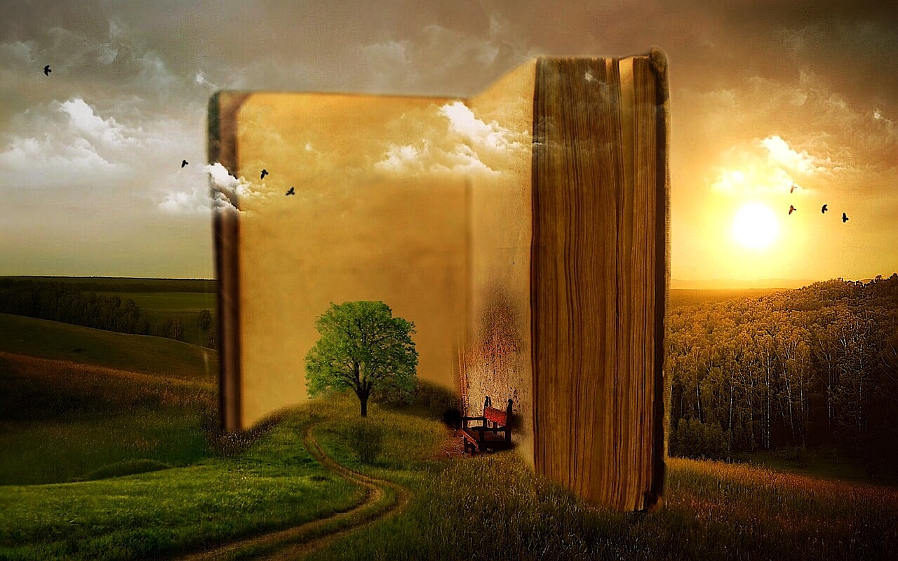 book standing open in fantasy land with setting sun, birds, trees, and a chair