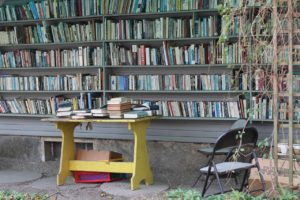 shelves of books at a store, outdoors