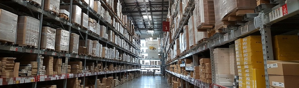 shelves filled with boxes in a warehouse