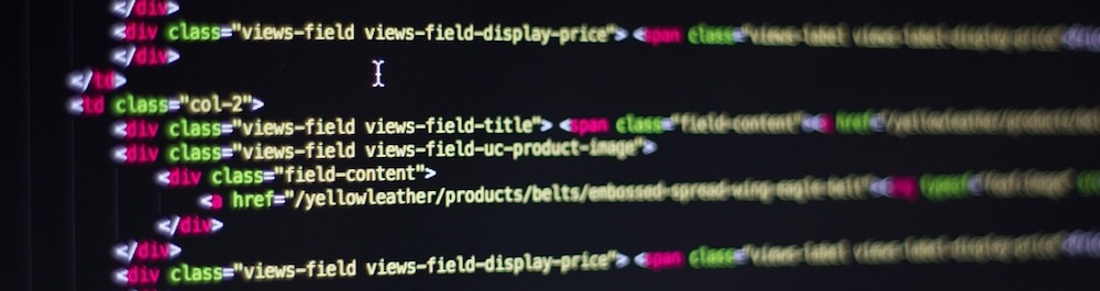 colorful code typed on a black computer screen