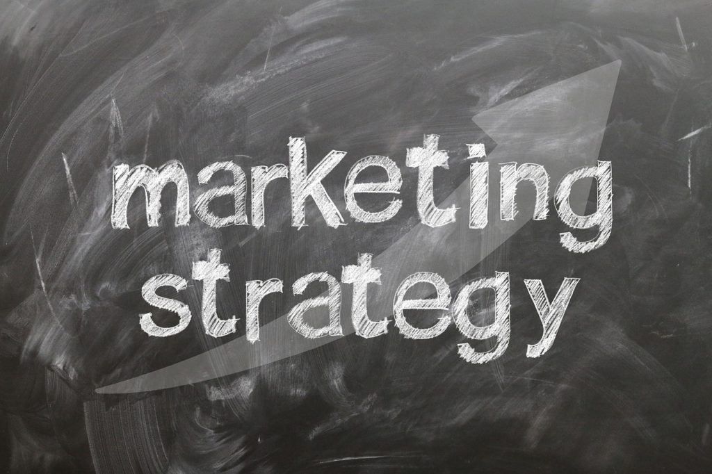 "the words ""marketing strategy"" written in chalk on a dusty chalkboard"
