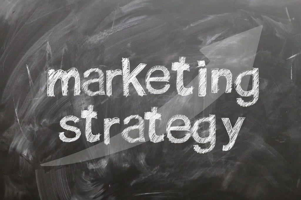 """the words """"marketing strategy"""" written in chalk on a dusty chalkboard"""