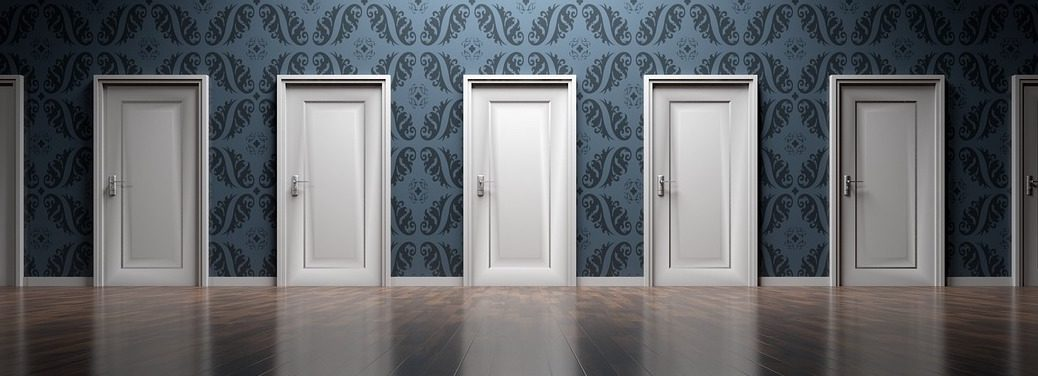 a row of identical doors in a wall with fancy wallpaper, with a wooden floor below